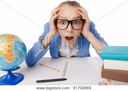 Shocked overwhelmed student wearing glasses