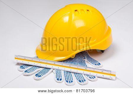 Builder's Tools - Helmet, Work Gloves And Ruler Over White
