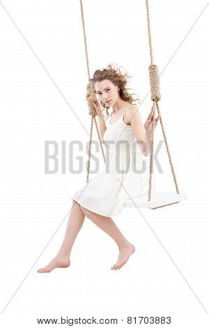 Beautiful woman sitting on swing isolated