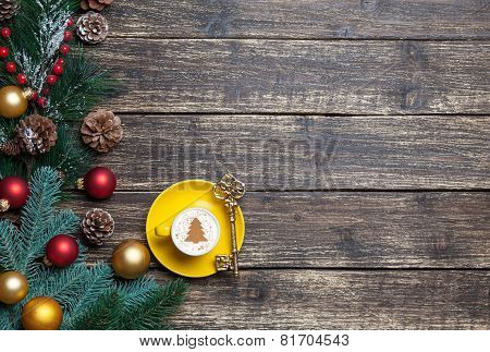 Cappuccino With Christmas Tree Shape And Pine Branch On Wooden Table.