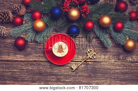 Hot Cappuccino With Christmas Tree Shape On A Wooden Table Near Pine Branches