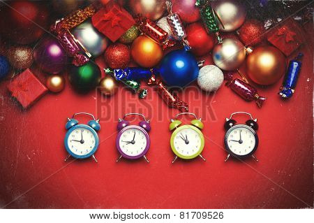 Four Clocks Near Christmas Gifts