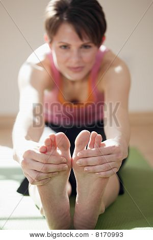 Young Woman Touching Her Toes