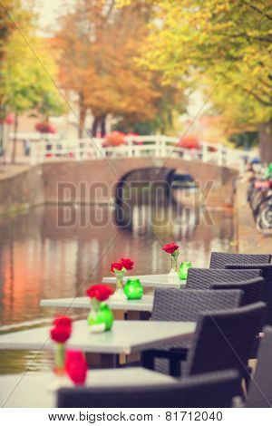 Tables With Flowers Near Channel In Delft, Holland