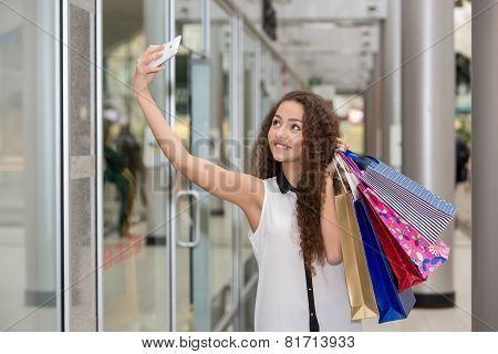 beautiful young woman goes shopping