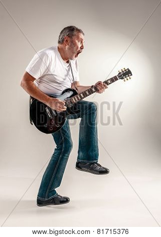 Full length portrait of a guitar player
