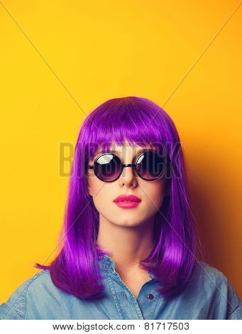 Beautiful Girl With Violet Hair In Sunglasses On Yellow Background.