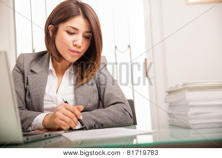 Female Lawyer Signing Documents