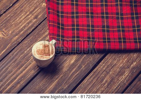Cup With Coffee And Shape Of The Cacao Heart On It And Scarf.