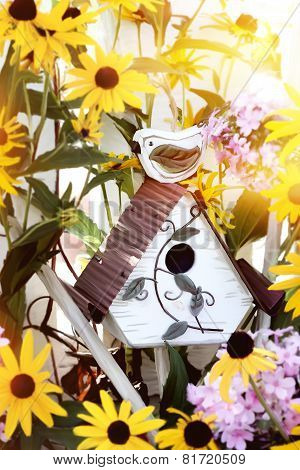 Birdhouse In Flowers