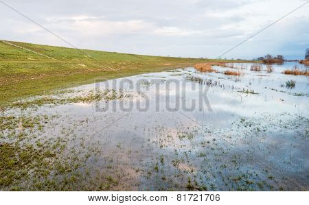 Flooded Grass Next To A Dike