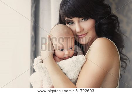 Young mother with her baby in her arms.
