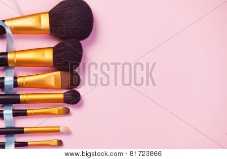 Brushes On Pink Background.