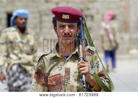 Yemeni military man holds Kalashnikov machine gun, Hadramaut valley, Yemen.