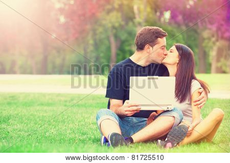 Teen Couple With Notebook In The Park