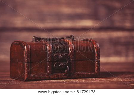 Casket On Wooden Table.