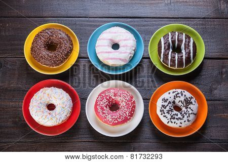 Donuts On Wooden Table.