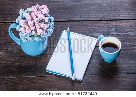 Cup Of Coffee With Notebook And Pencil, On Wooden Table.
