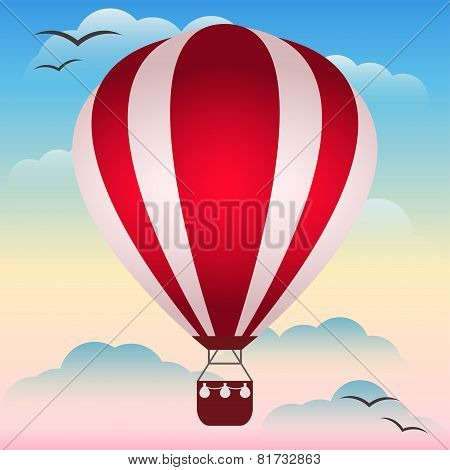 Bright Hot Air Balloon Floating In The Sunset Sky