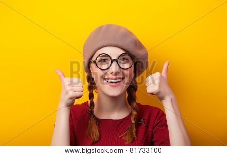Redhead Girl With Pigtails On Yellow Background.