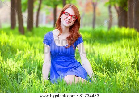 Redhead Women With Glasses In The Park.