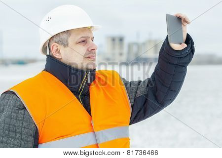 Engineer with tablet PC on the field in winter