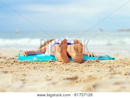 Little Girl Sunbathing On Sand. Place For Text.