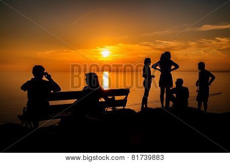 People Waiting For A Sunset