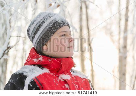 Teenager boy in winter park