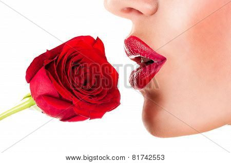 sexy woman smelling flower, sensual red lips