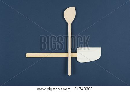 Wooden Spoon And Spatula On A Blue Background