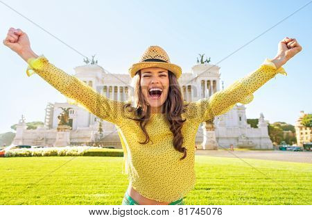 Portrait Of Happy Young Woman Rejoicing On Piazza Venezia In Rom