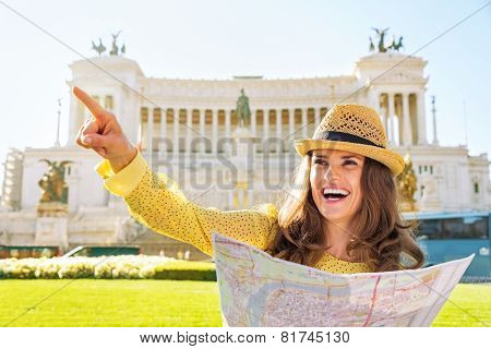 Happy Young Woman With Map On Piazza Venezia In Rome, Italy Poin