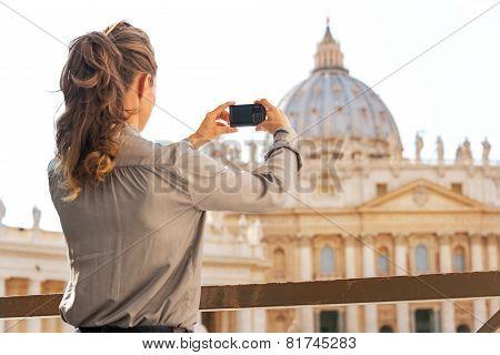 Young Woman Taking Photo Of Basilica Di San Pietro In Vatican Ci
