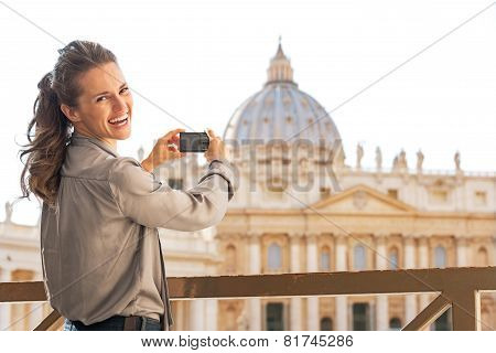 Portrait Of Happy Young Woman Taking Photo Of Basilica Di San Pietro In Vatican City State