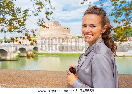 Happy Young Woman With Photo Camera Standing On Embankment Near