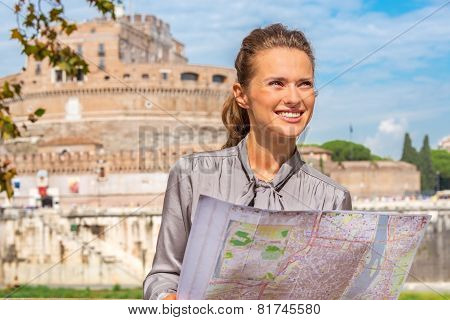 Portrait Of Happy Young Woman With Map On Embankment Near Castel
