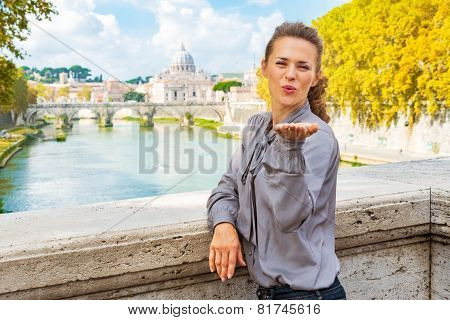 Young Woman Blowing Kiss From Ponte Umberto I With View On Basil