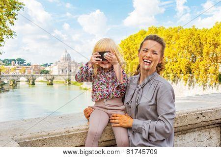 Happy Mother And Baby Girl With Photo Camera On Bridge Ponte Umb