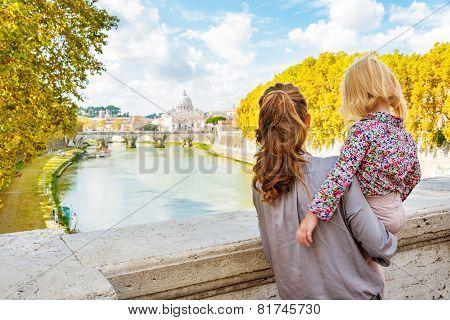 Happy Mother And Baby Girl Sightseeing On Bridge Ponte Umberto I