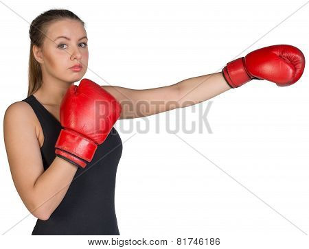 Woman wearing boxing gloves, in punching pose