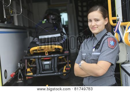 Paramedic employee with ambulance in the background.