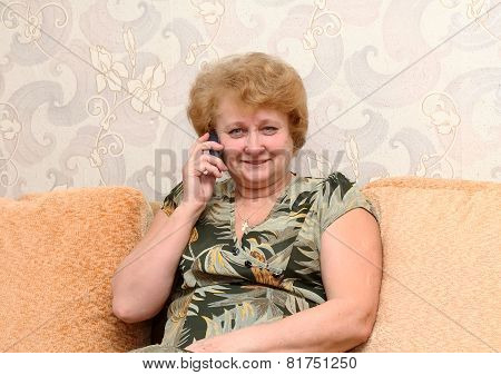 Senior Lady Speaks By A Mobile Phone.