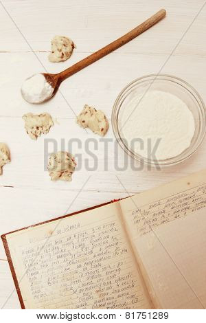Dough with old cookbook