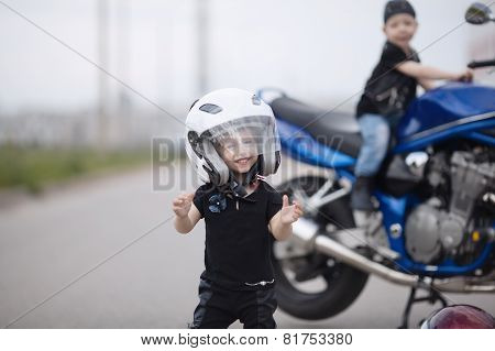 little bikers on road with motorcycle