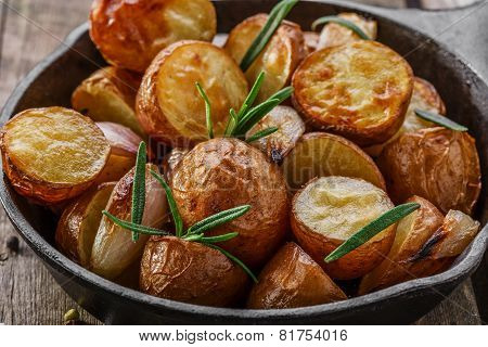 baked potatoes in a pan with rosemary