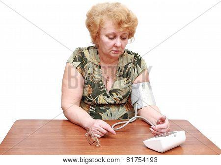 Senior Lady Measures Arterial Pressure.