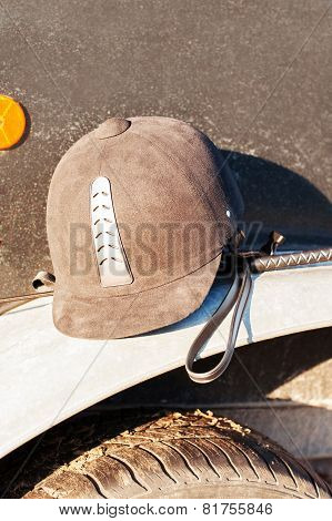 Equestrian Helmet Forgotten On Horse Trailer's Fender.