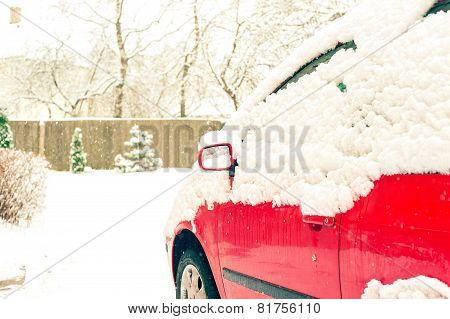 Red Car And Mirror Snow Capped. Winter-time Outside. Outdoors.