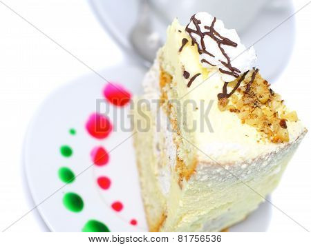 Sponge Cake And  Cup Of Coffee. Isolated
